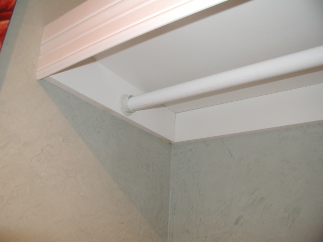 base moulding conceals curtain rod in laundry room