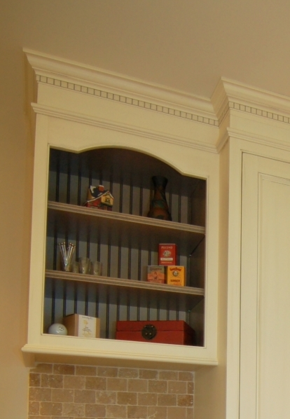 cabinets over stove will be replaced with an open display cabinet