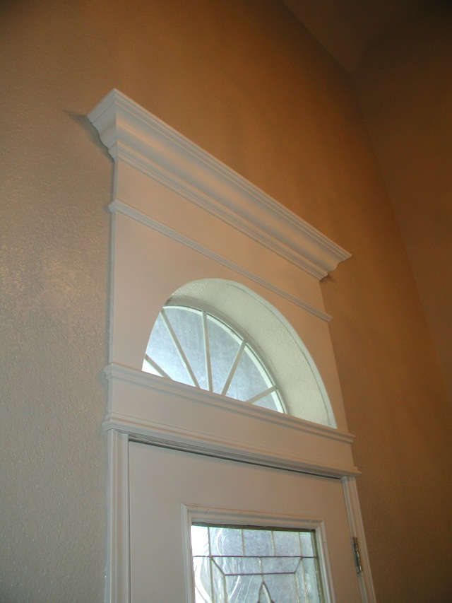 crown moulding over entry door