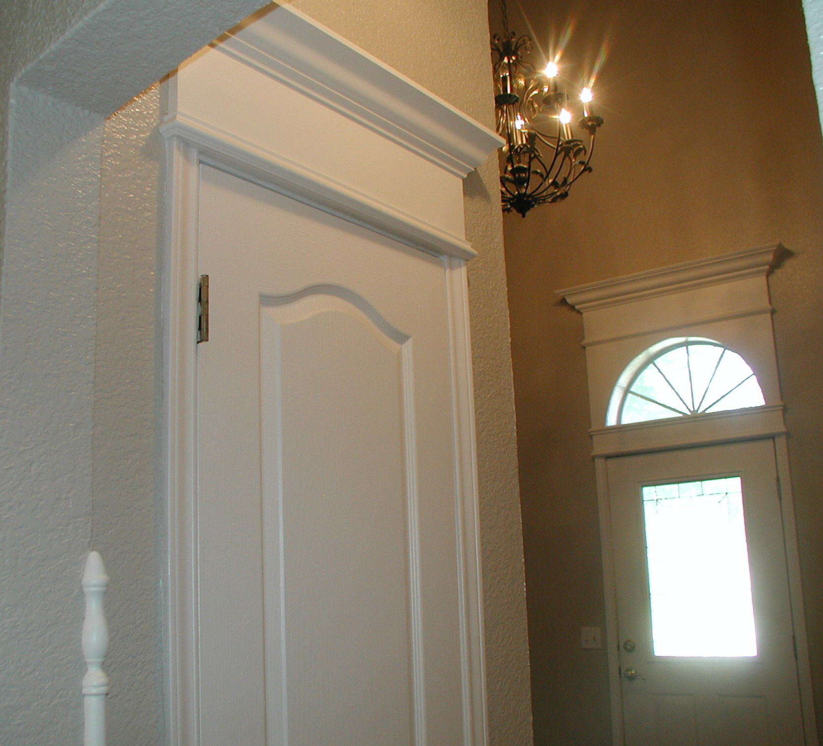 Project cornice of crown moulding over door simply for Exterior closet doors