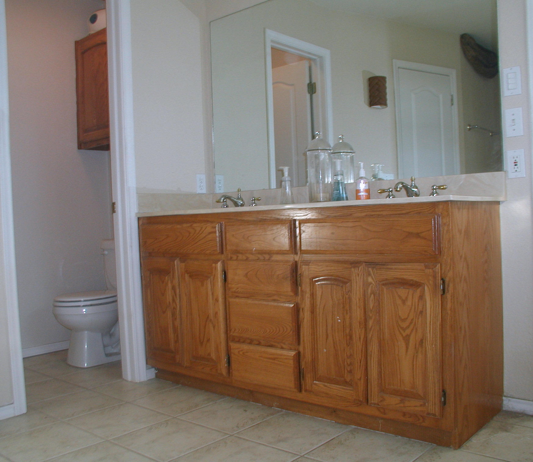 Project transforming builder grade cabinets to old world for Bathroom cabinet ideas photos