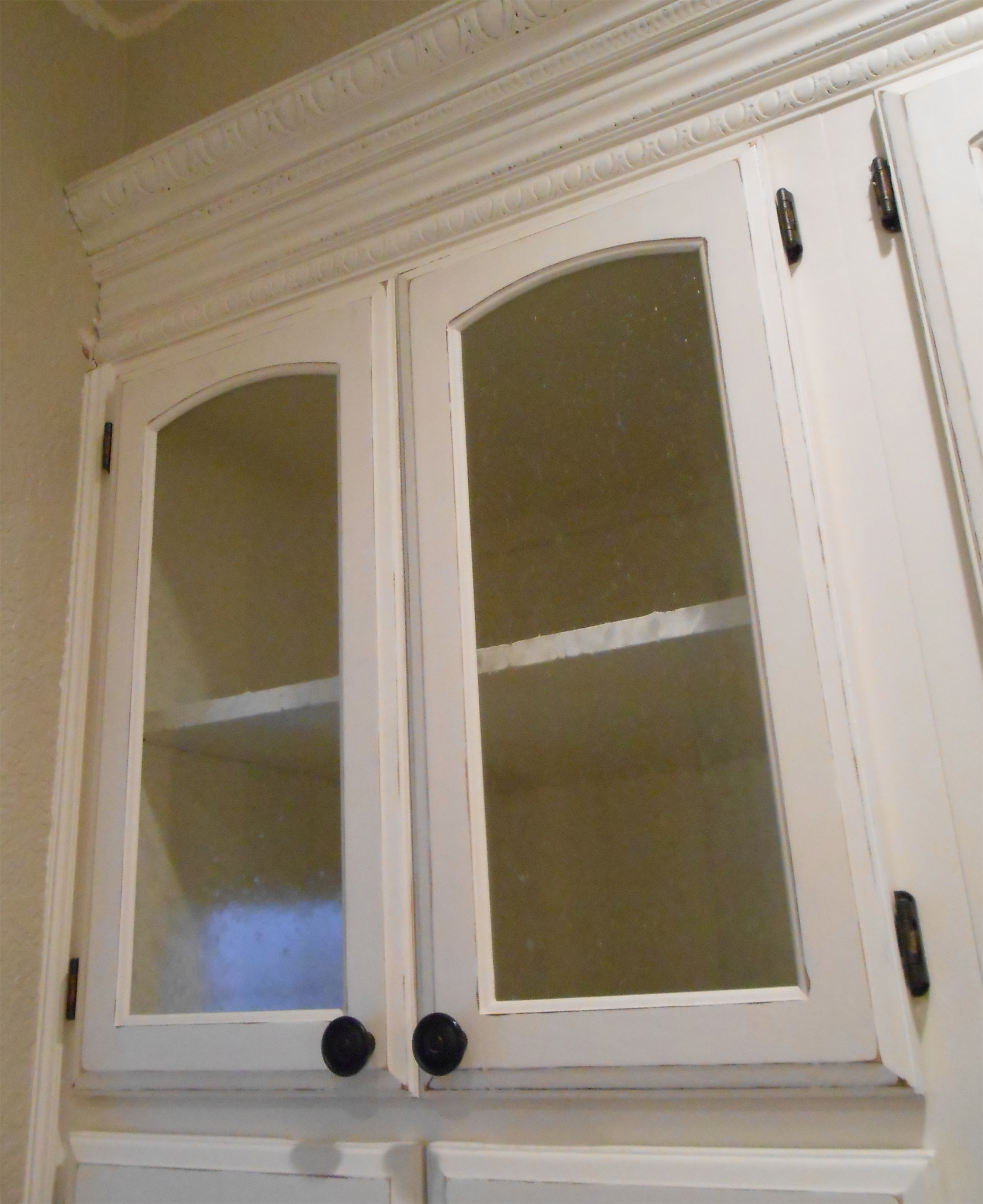 Kitchen_cabinet_fridge_glass_cabinet_doors_painted.  Kitchen_fridge_cabinets_before_after_paint1